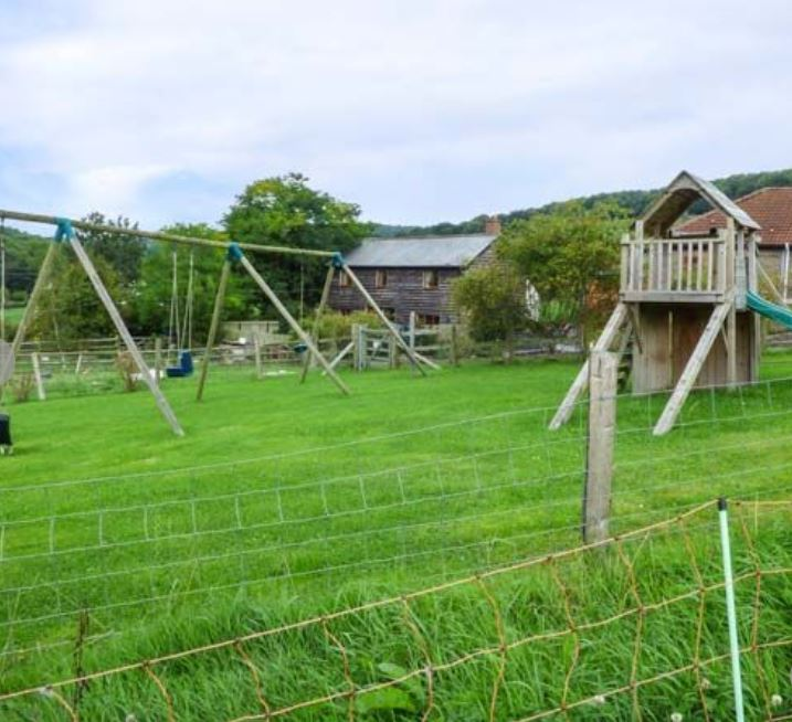 Childrens play area at child friendly accommodation near Ledbury
