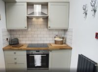 Kitchen area in Ledbury holiday home